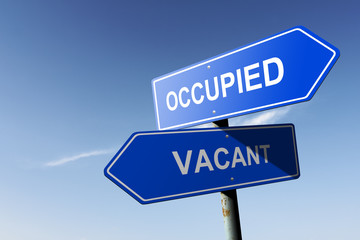 Occupied and Vacant directions.  Opposite traffic sign.