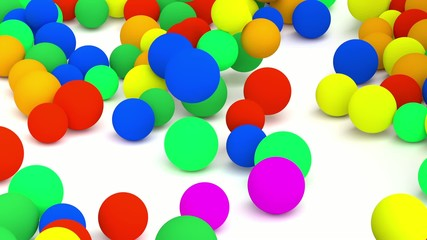 Falling colored spheres.