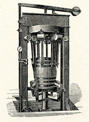 Machine for fitting metal hoops around the wooden barrels