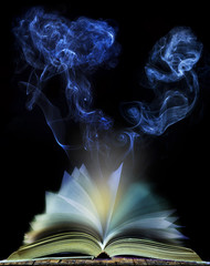 abstract of  open book page with moving smoke on black backgroun