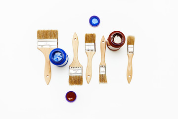 Set of five new renovation brushes with paint