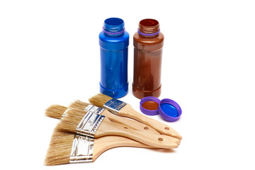 Renovation tools: brushes with paint