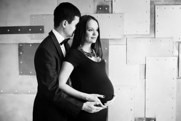 Young elegance pregnant family