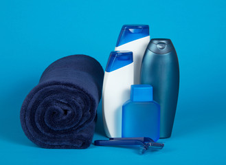 The razor, lotion, shampoo and towel