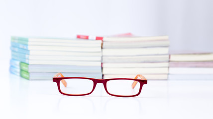 Eyeglasses with stack of book background