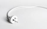 A white Australian power cord plug on white background