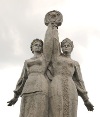 OLSoviet monument.  Russian and Ukrainian girls hold hands