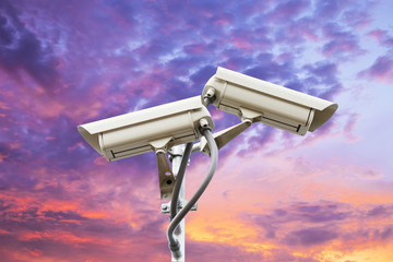 Security camera on colorful sky background