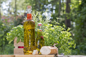 herbs in olive oil bottles