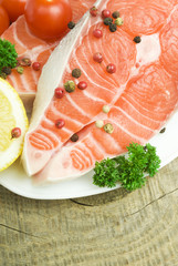 Salmon steak with lemon and parsley