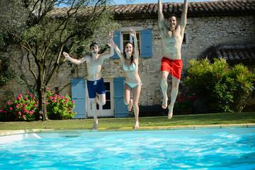 group friends jumping resorts swimming pool summer holidays