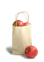 Apple in shopping bag