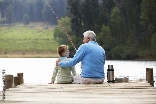 Plexiglas Vissen Senior man fishing with grandson