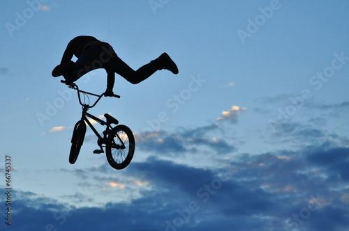 Deurstickers Fietsen Silhouette of a BMX rider making a bike jump in the air