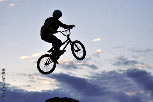 Foto op Canvas Fietsen BMX rider making a bike jump
