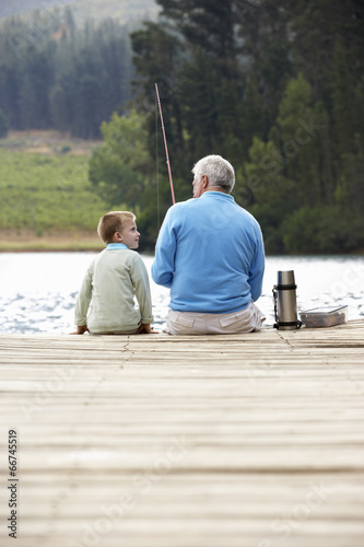 Tuinposter Vissen Senior man fishing with grandson