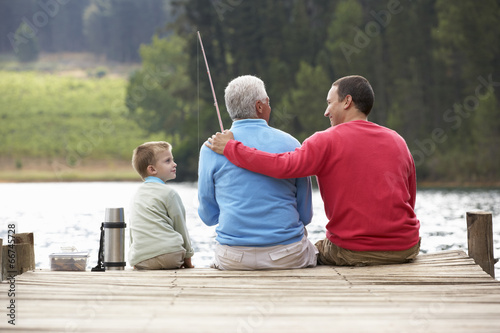 Tuinposter Vissen Father,son and grandfather fishing