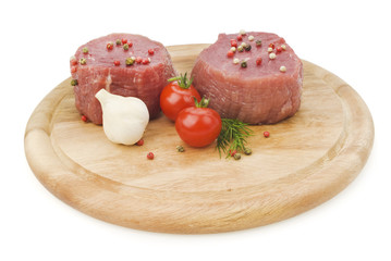 raw steak with tomatoes and garlic and pepper