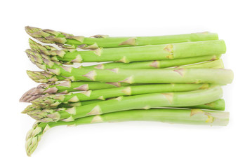fresh green asparagus tips on a white background