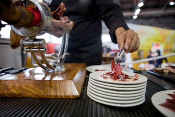 Serving acorn-fed Iberian ham