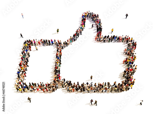 Large group of people in the shape of a thumbs up.