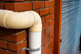 stormwater pipe or downspout hanging on the corner of the house poster
