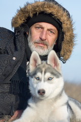 Man with his dog. Siberian Husky.