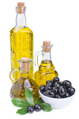 bottles of olive oil and black olives with leaves