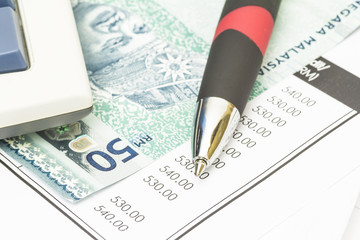 Ball pen, bank note and bank statement - financial concept