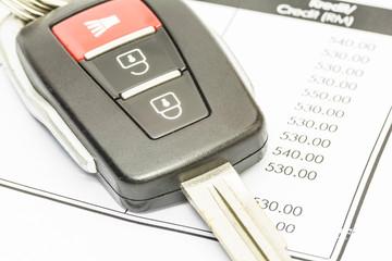 Closu up car key on bank statement