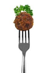 Meatball with herbs on a fork isolated over white