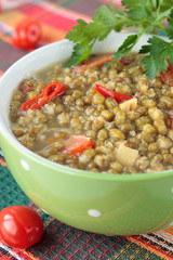 Mung bean soup with peppers in bowl
