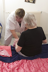 Nurse caring for senior at home