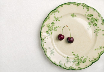 Plate with fresh cherry