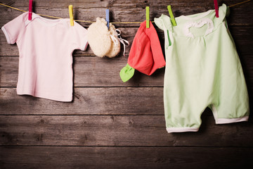 children's clothing on a wooden background