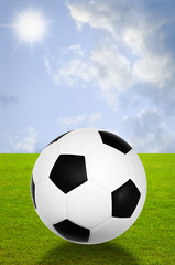 Football with field and sky background