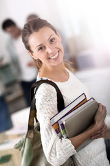 College girl holding books and going to class