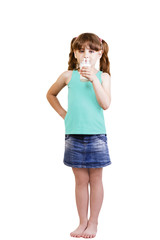 5-6 years old girl with a glass of milk drinks
