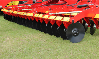 A Large Disc Harrow Trailer for a Farming Tractor.