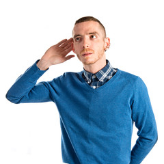 Man hearing something over white background