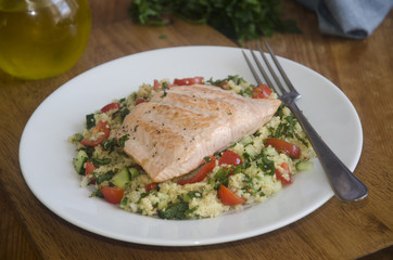 Baked salmon steak with tabbouleh