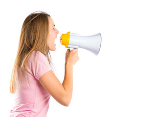 Blonde girl shouting with a megaphone over white background