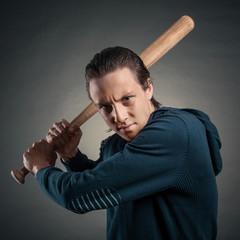 young man swings the bat