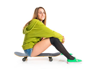 Pretty young girl wearing urban style with skateboard