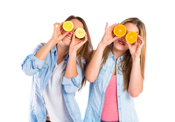 Friends playing with fruits over white background