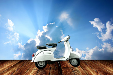 Vintage motorcycle with sky background