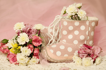 Sweet baby girl birthday background with shoes and roses flowers