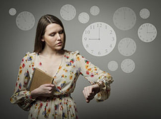 Young woman and wristwatch. 9 p.m.