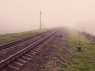 railroad track in fog