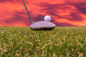 golf driver and sunset